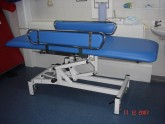 Re-upholstered hospital changing table